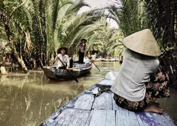 In Booten entdecken wir die Flussarme im Mekongdelta in Vietnam.