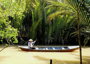 Holzboot im Mekongdelta